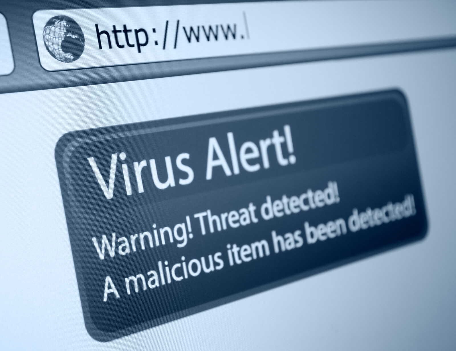 Closeup of virus alert on browser screen in grayscale