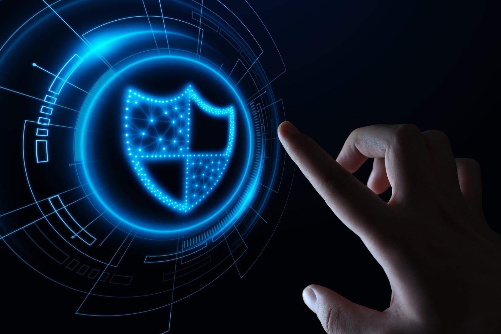Blue hologram of a cyber shield symbolizing internet security