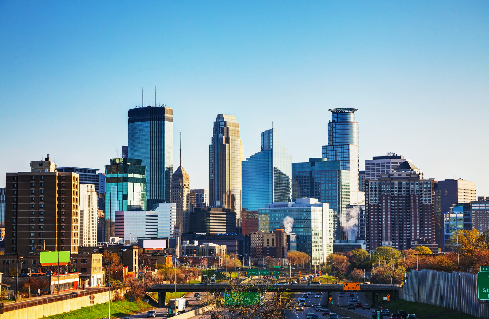 Downtown Minneapolis, in the morning with blue skies backing the minneapolis skyline