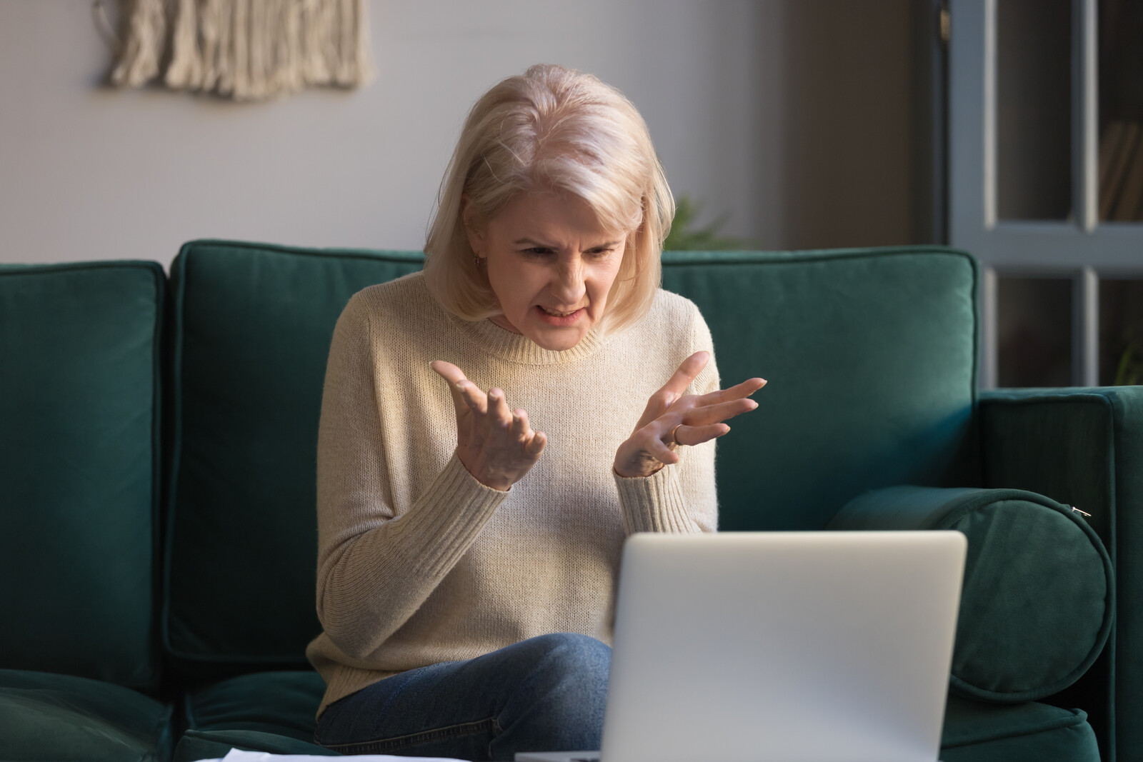 Frustrated mature female get mad because she is having issues with fake antivirus software