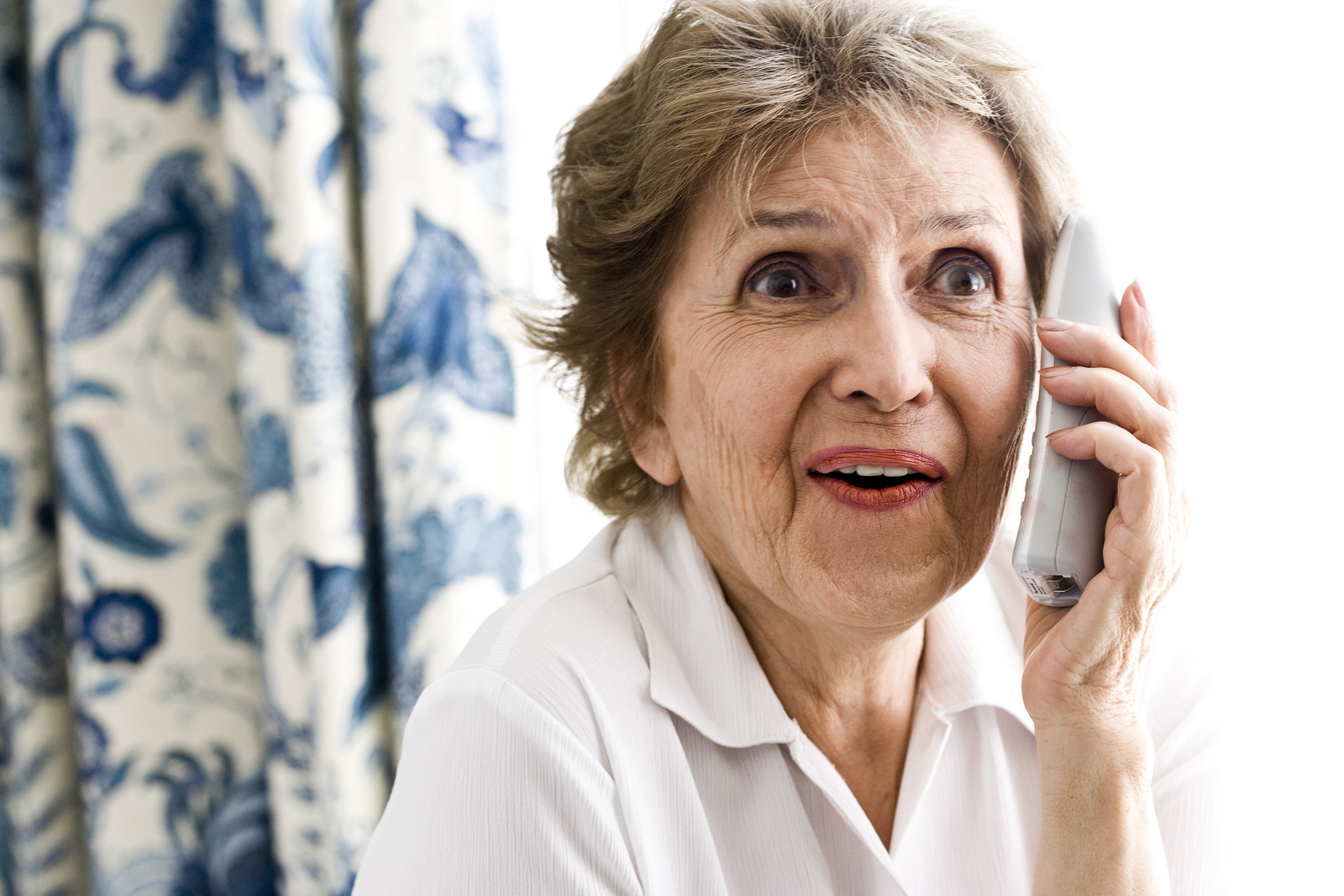 Senior Woman on phone looking engaged in the conversation