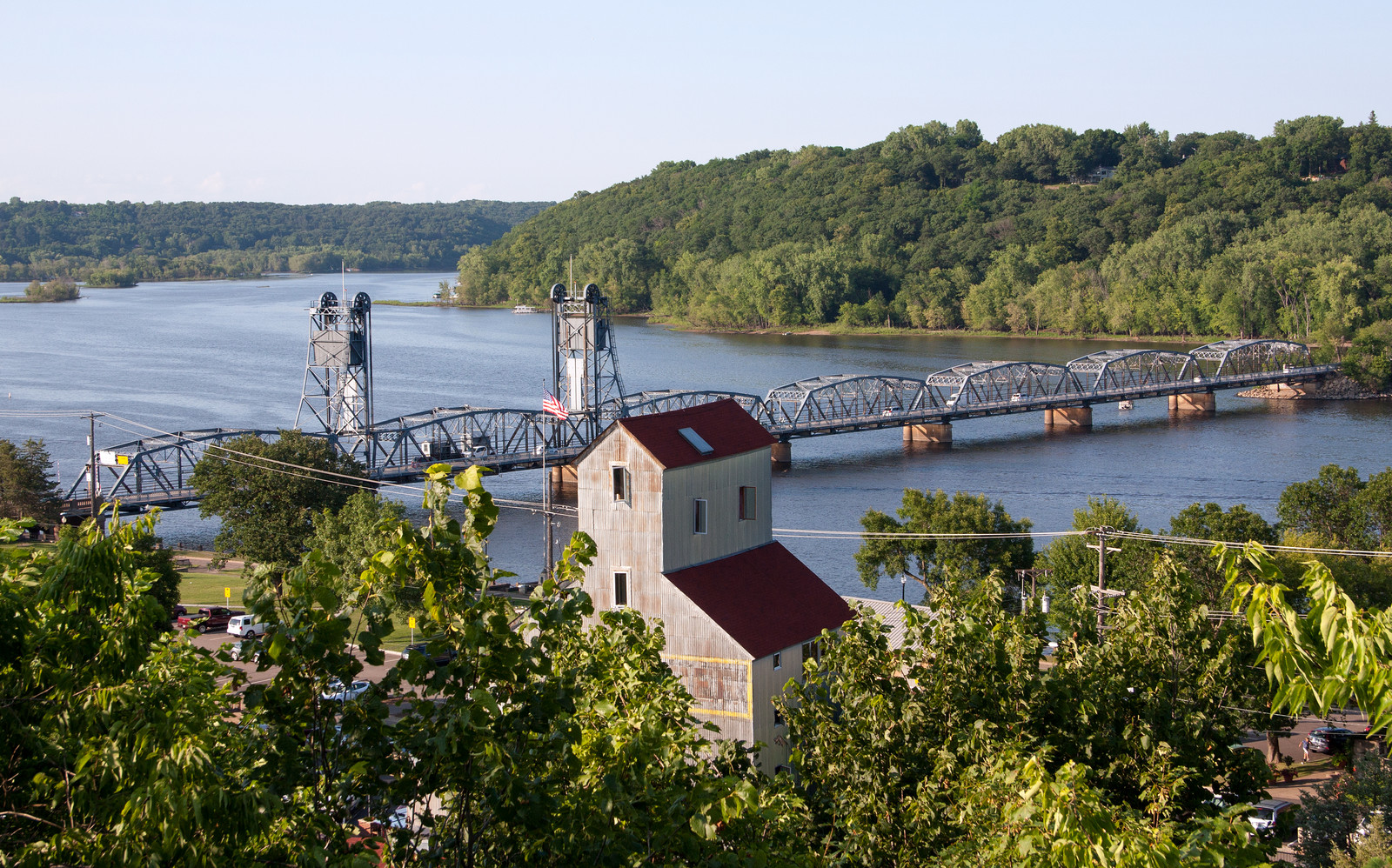 Photo from above the st. croix river with the lift bridge - green trees lining the river