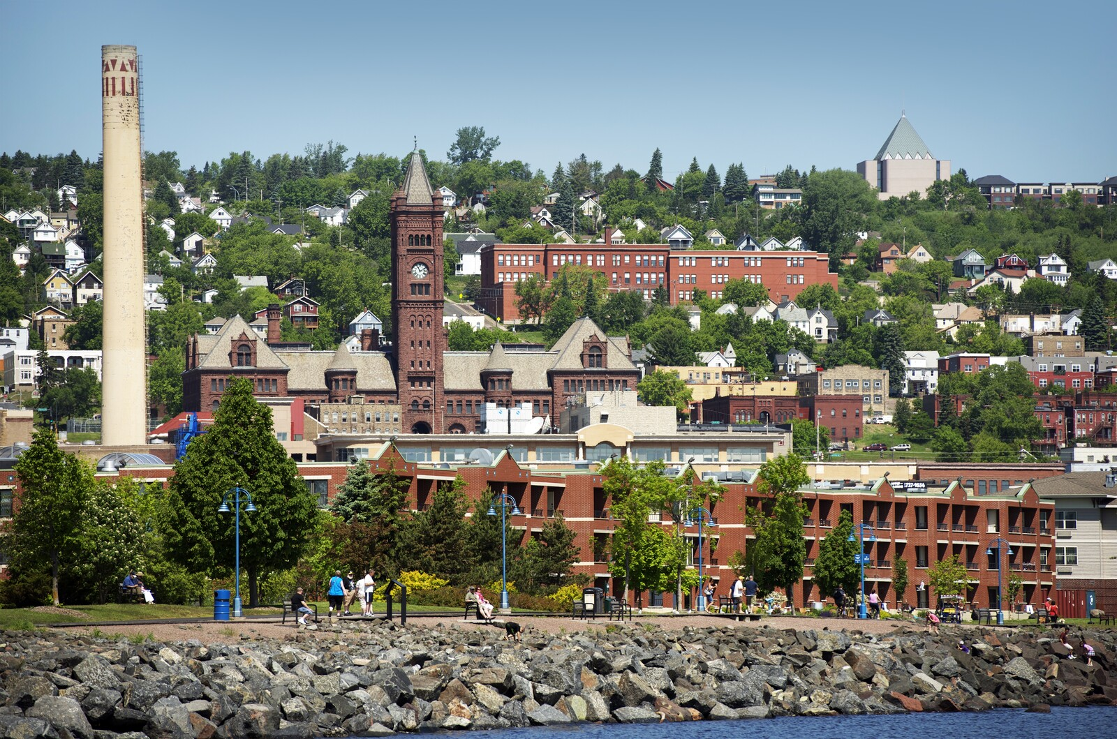 Photo from lake superior looking into duluth canal park area with the boardwalk along the lake