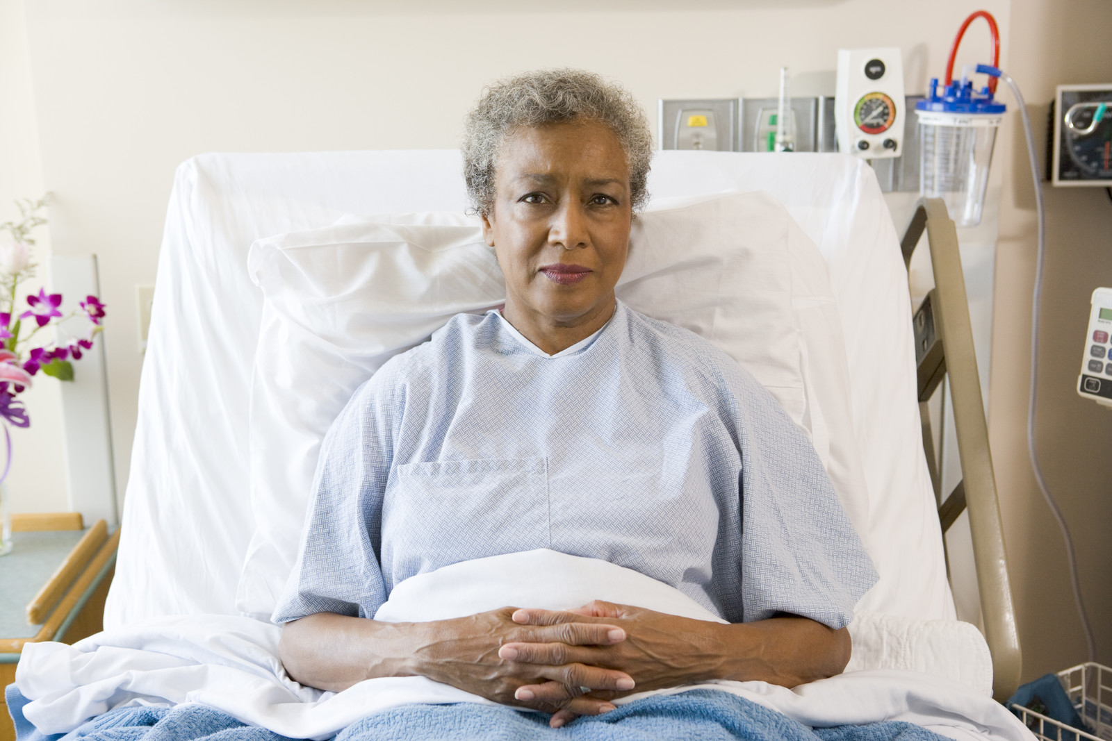 Senior woman sitting up in a hospital bed
