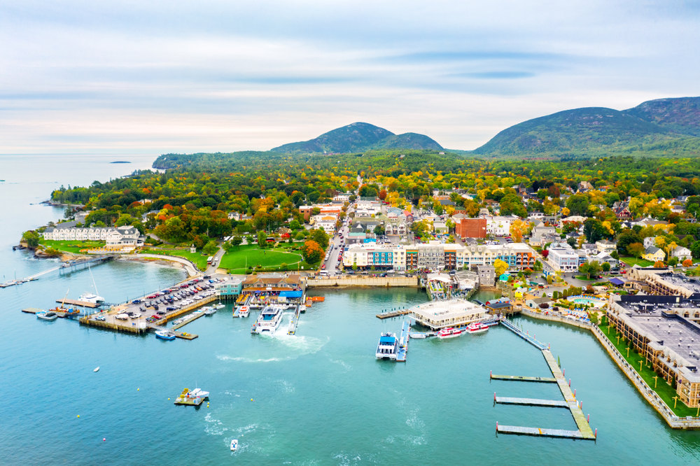 The waterfront in Bar Harbor Maine on a sunny day where the water is light blue and clear