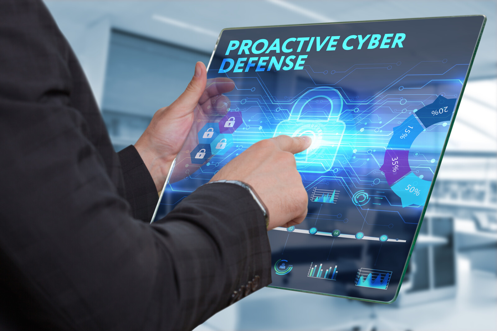 business man working on the tablet of the future, select on the virtual display: proactive cyber defense