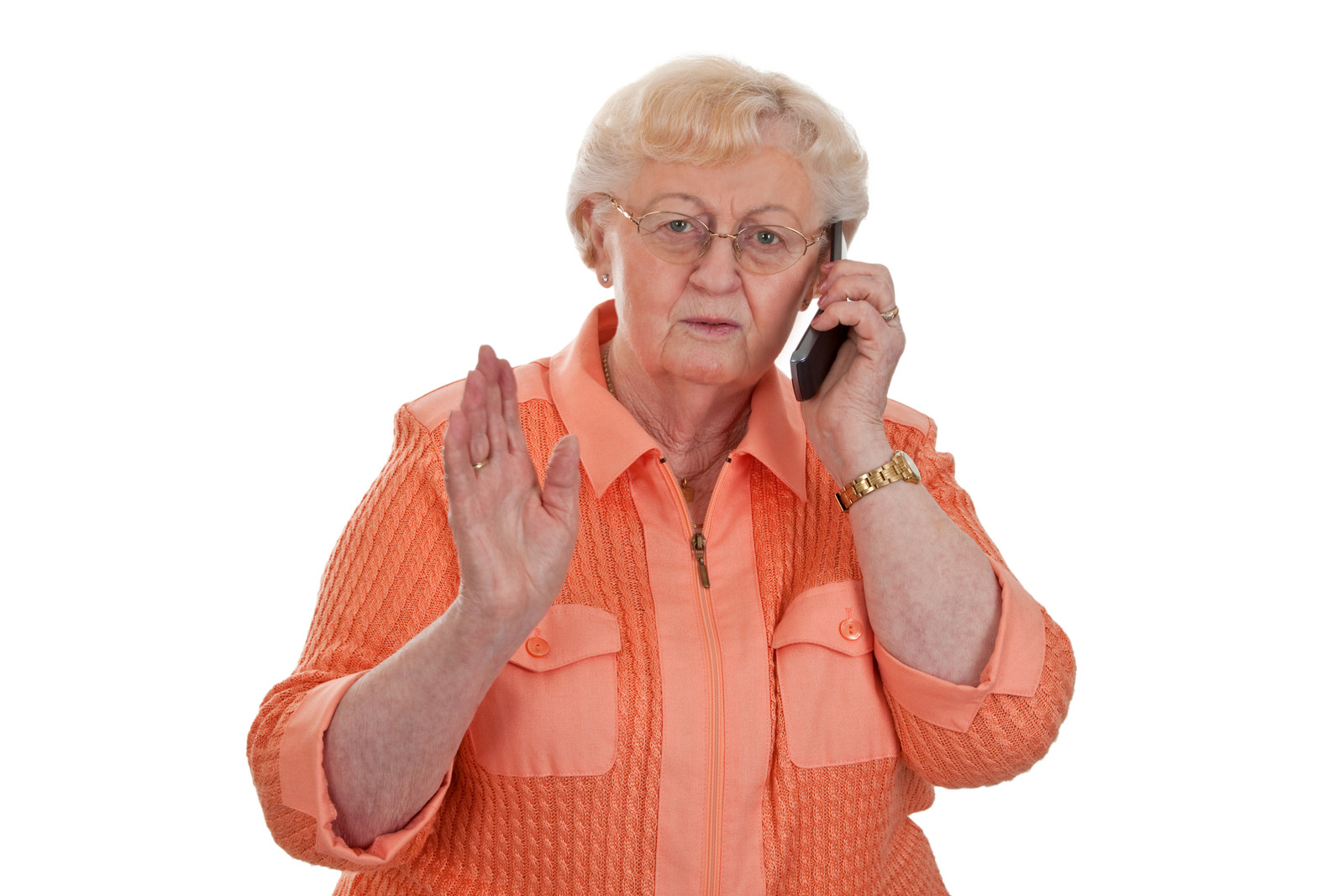 senior woman on the phone with her hand up in a stop motion