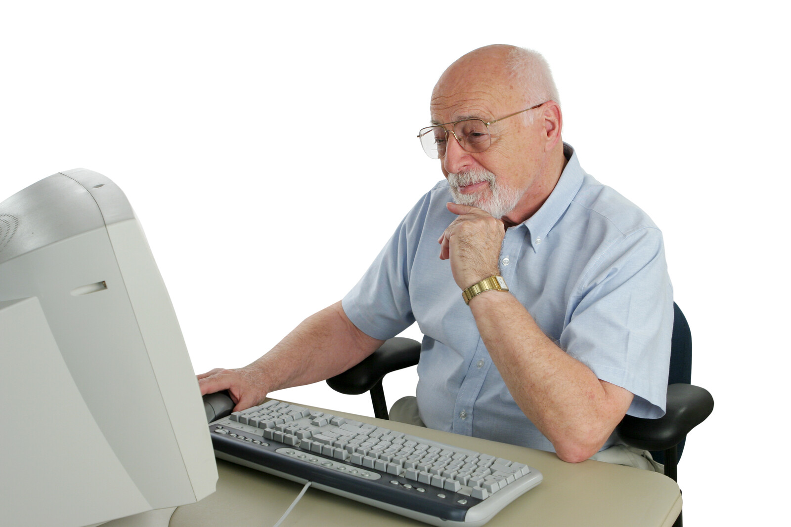 Senior man sitting at computer doing research online.