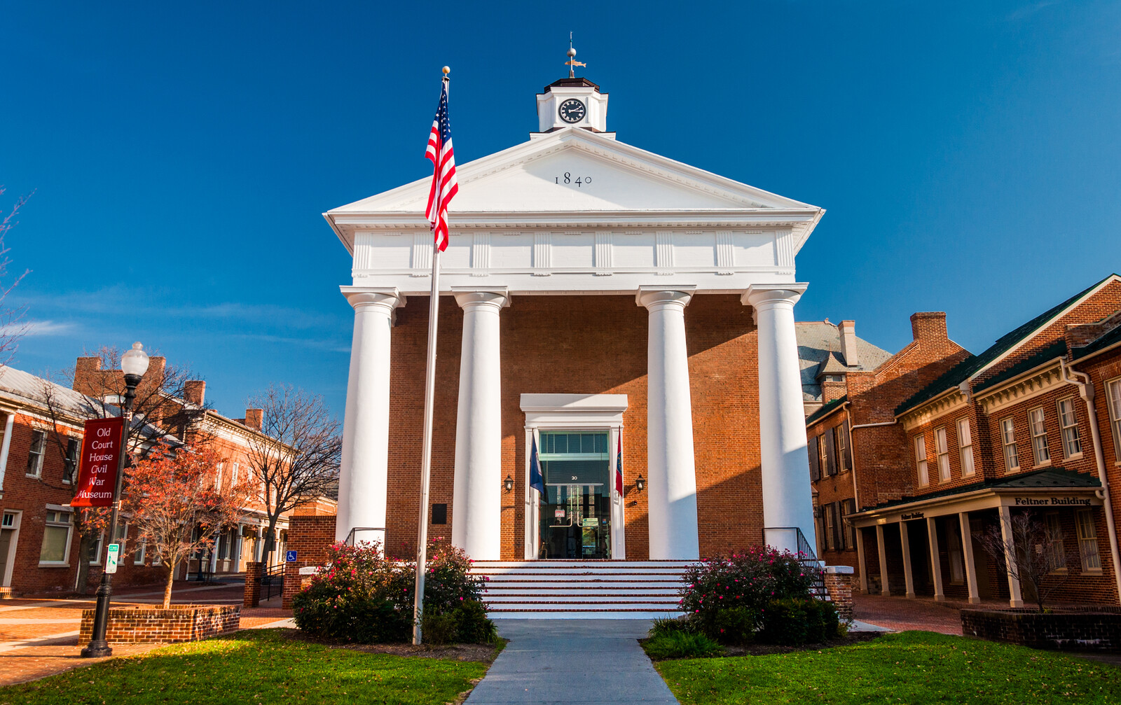 The courthouse in Winchester Virginia, large brick building with white pillar entrance and nearby brick buildings