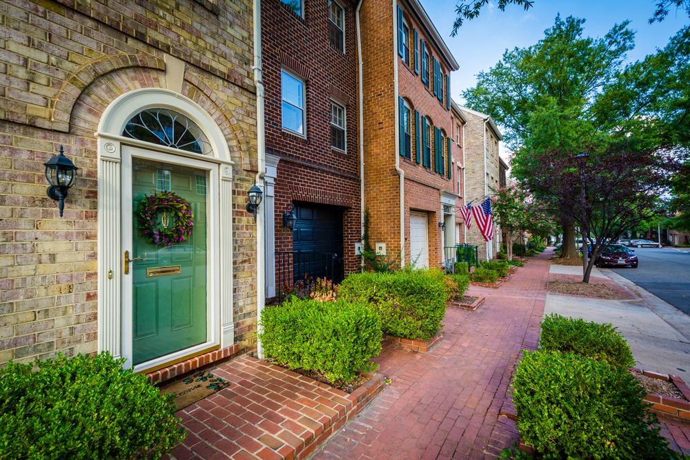 A row of houses in the Old Town of Alexandria Virginia, showing old fashioned buildings, box hedges and trees