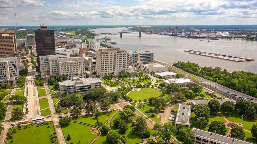 An aerial shot of Baton Rouge in Louisiana showing the various buildings, green parks, and trees