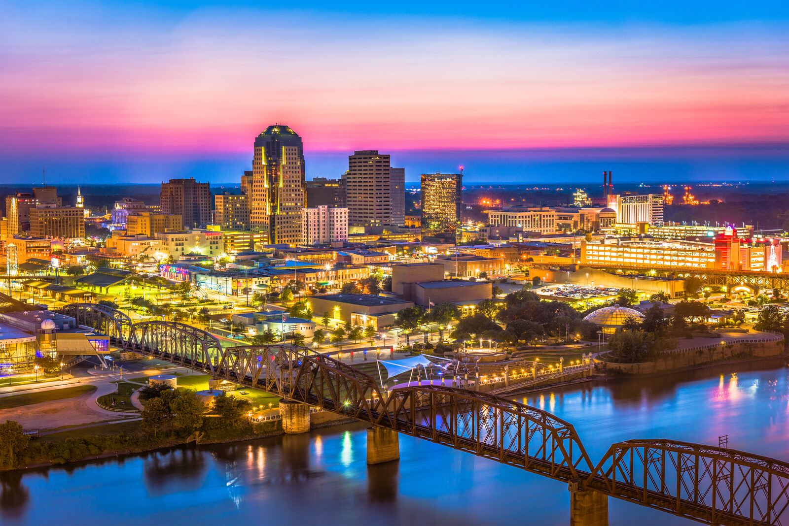 Downtown skyline of Shreveport, Louisiana along the red river at sunset