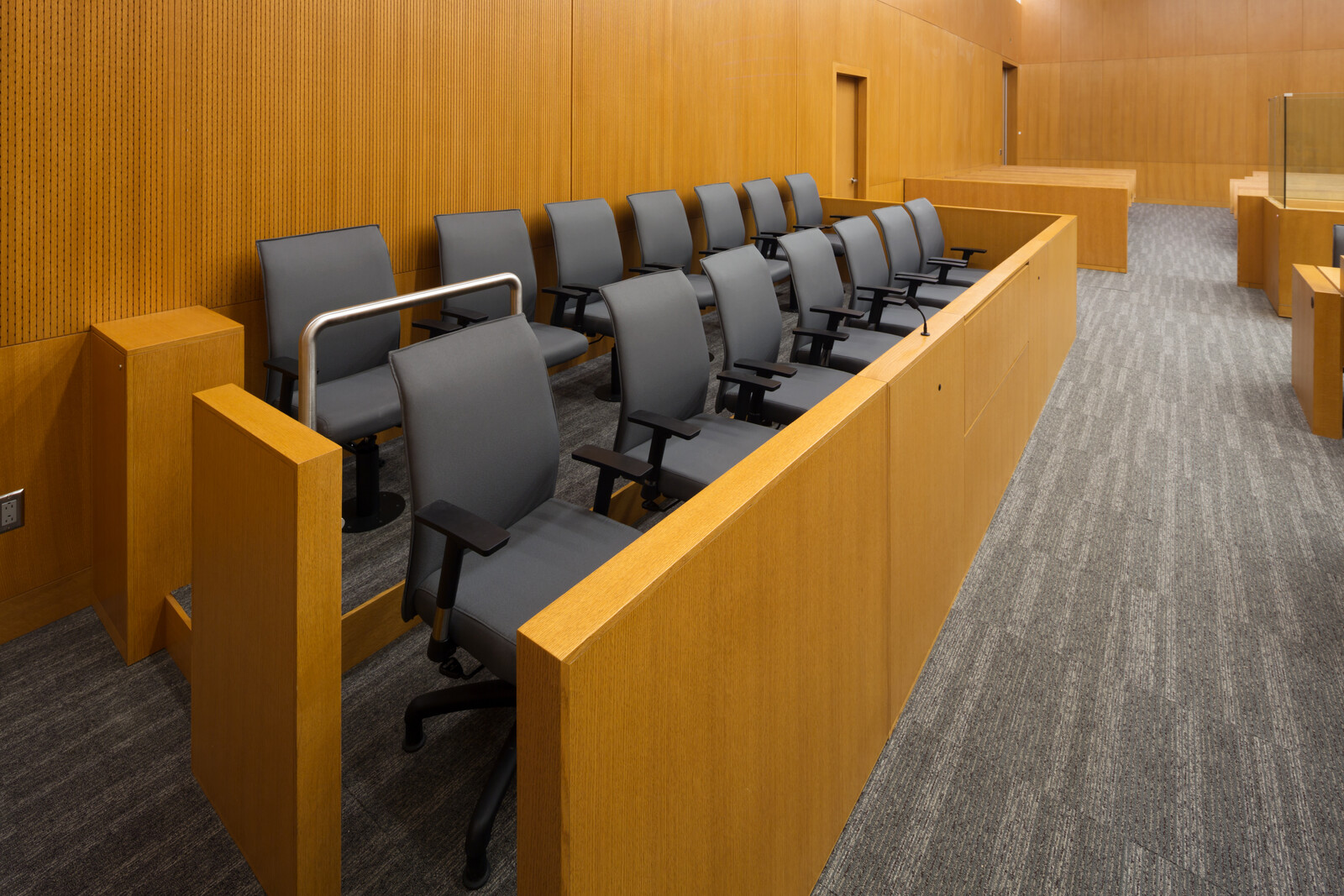 Ways to Spot a Jury Scam - Jury duty box in an empty courthouse