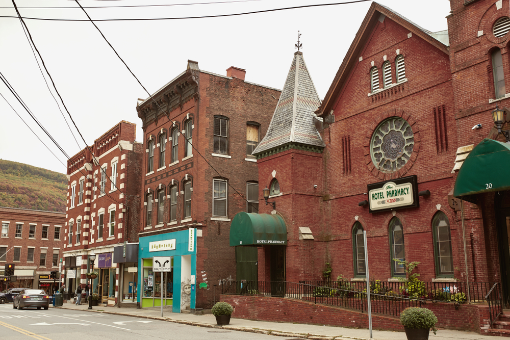 A collection of old buildings in the city of Brattleboro Vermont against a gray sky