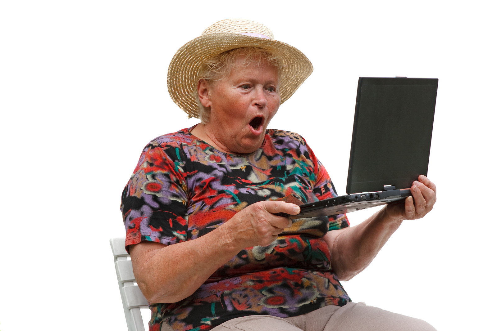 Senior woman looking at her laptop with a surprised look on her face because she just read an email stating she missed jury duty