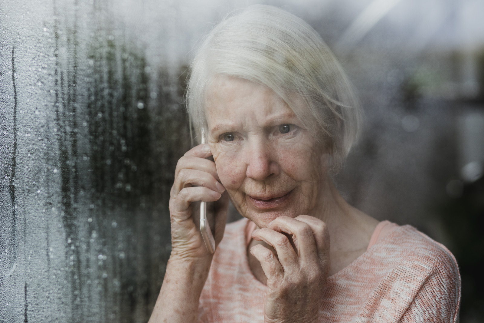 Senior woman on the phone reporting a crime