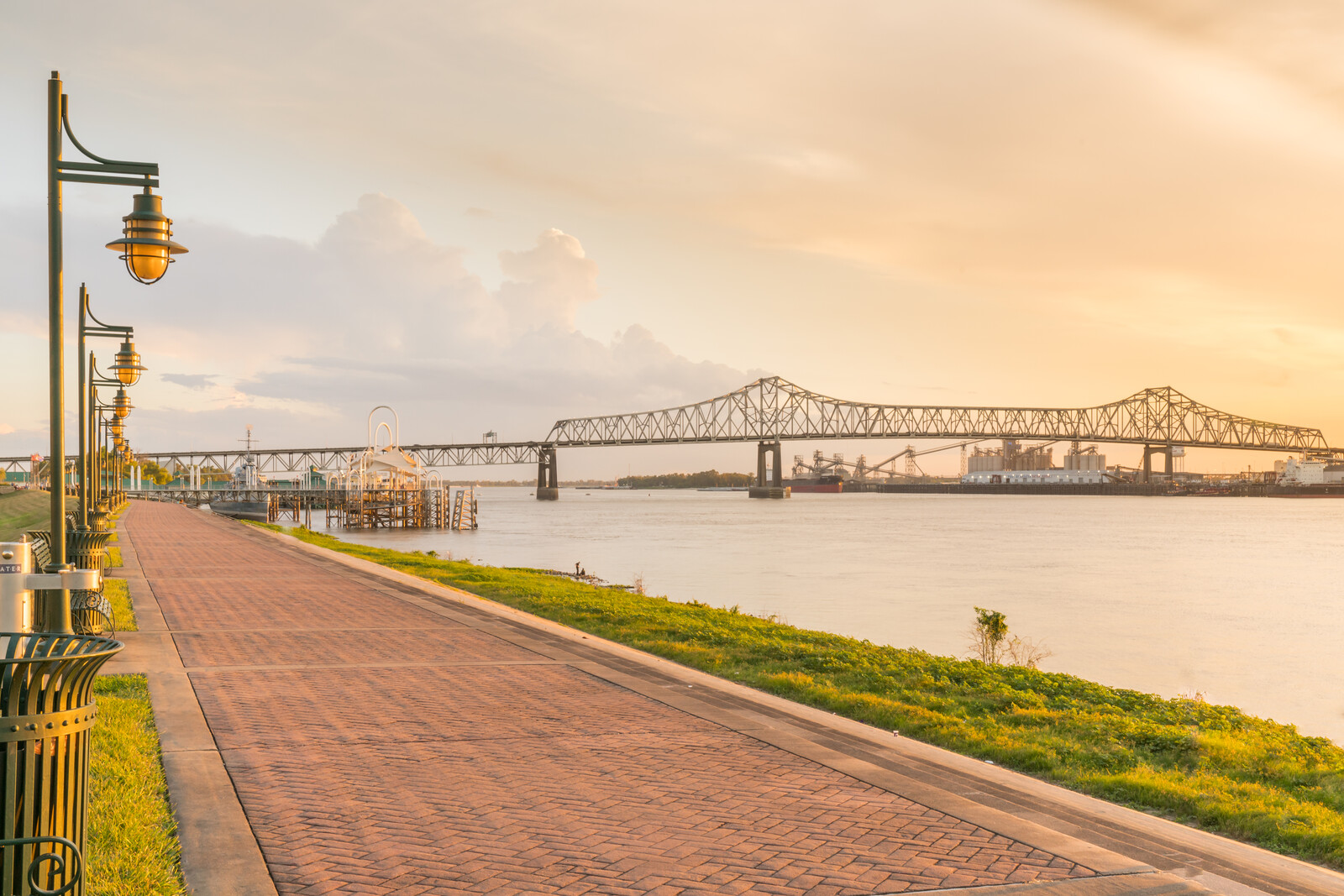 Walking path along the Mississippi river at sunrise in Baton Rouge, Louisiana