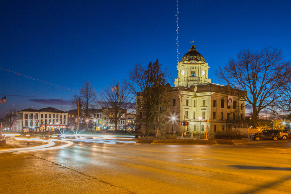 Bloomington Indiana at night where lights can be seen from cars with timelapse photography