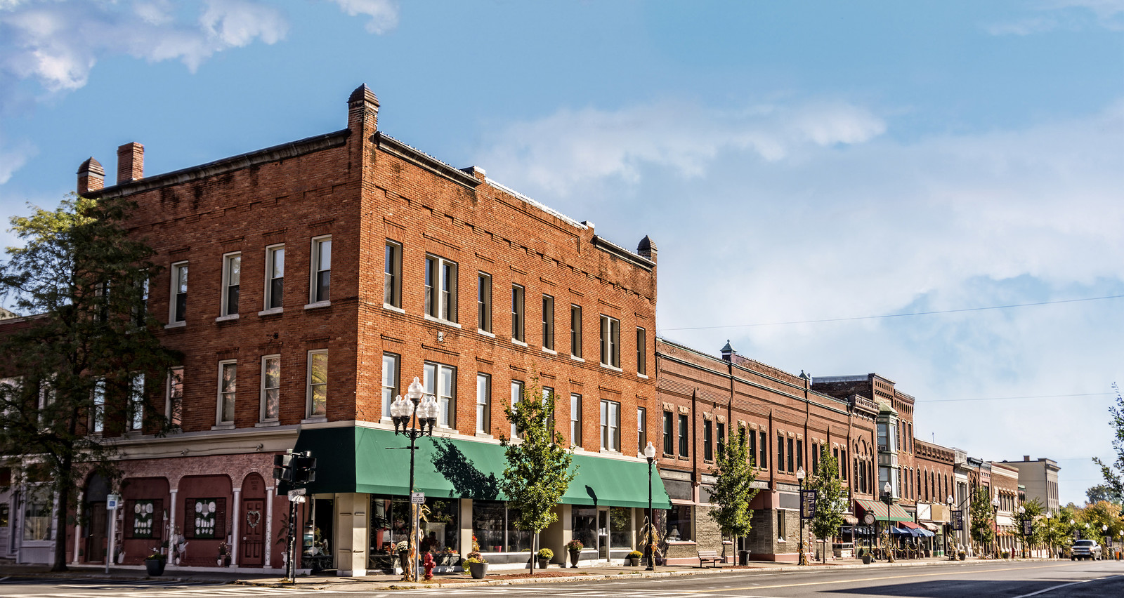 Small town with brick buildings lining the main street