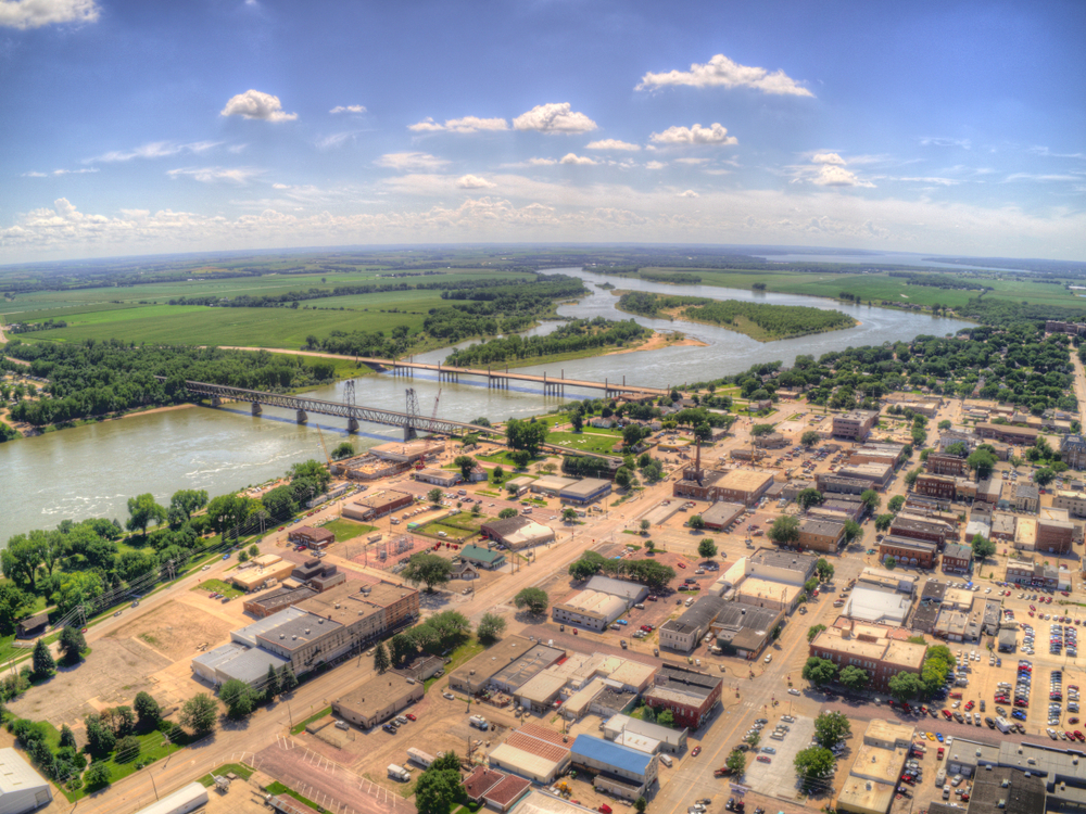 An aerial view of Yankton South Dakota showing a river and the brown streets