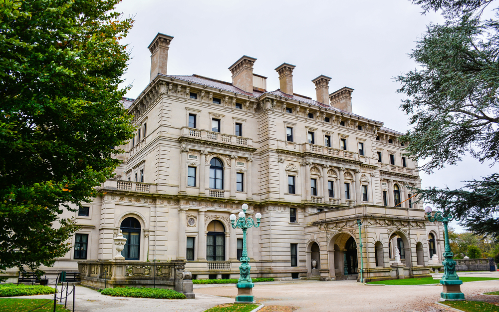 A Vanderbilt Masion called The Breakers in Newport Rhode Island with some trees and lamposts