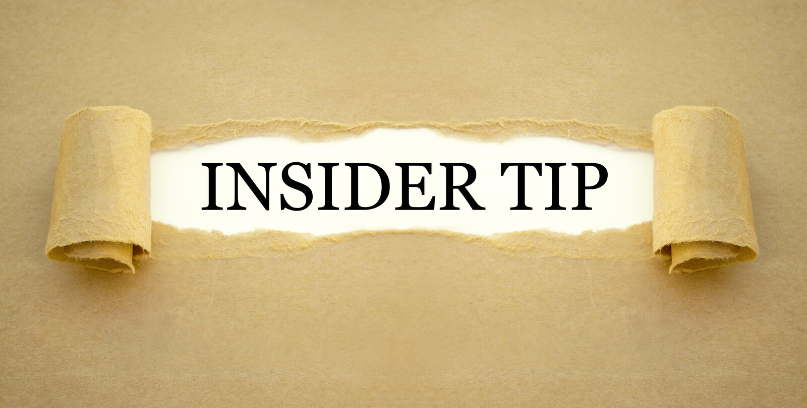Brown paper that shows a ripped hole showing insider tip