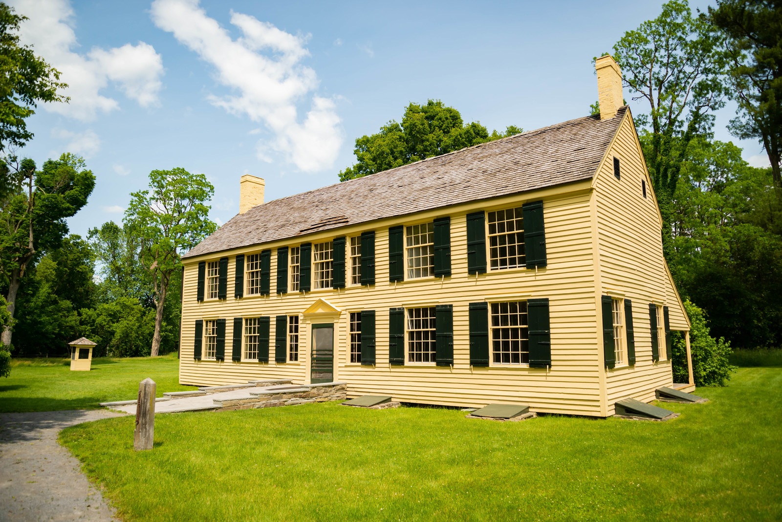 Yellow house with black shutters, General schuyer historical house in saratoga ny