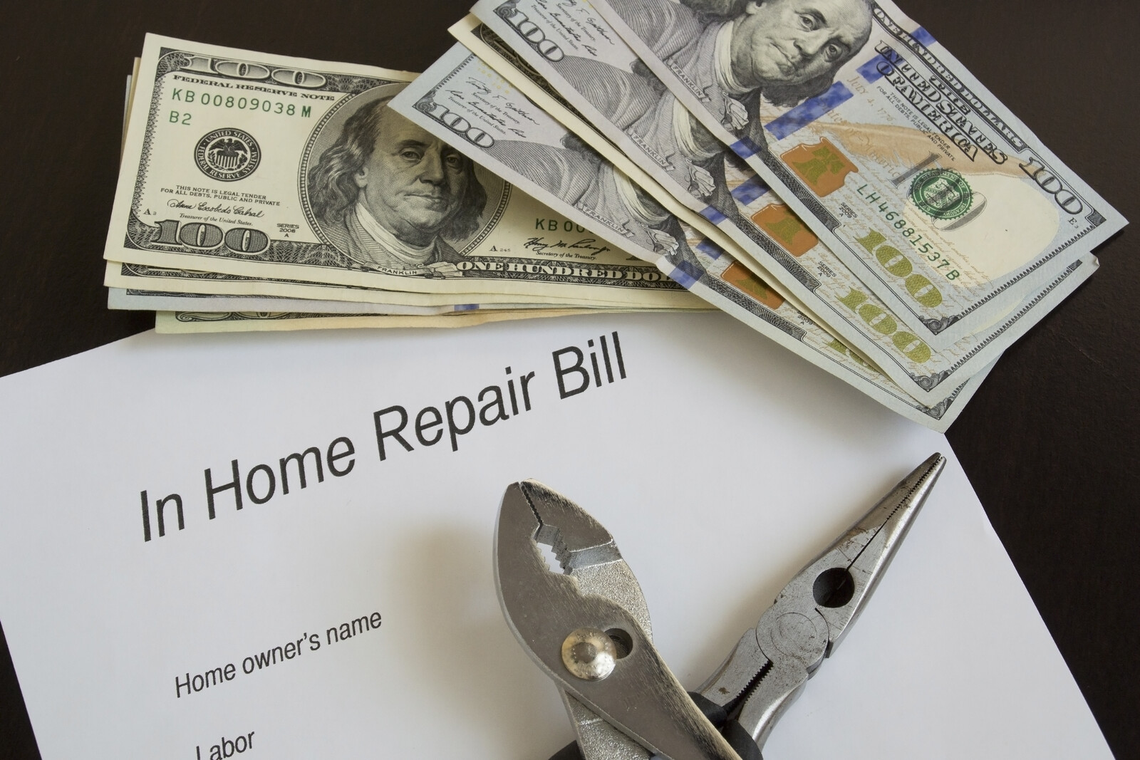 In Home Repair Bill with two pairs of pliers crosssed on top and near the top of the paper there are multiple 100 dollar bills