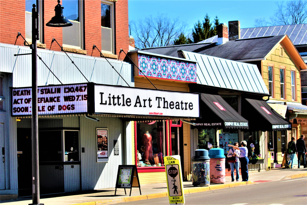 An indie theater in Yellow Springs Ohio with people standing around looking at shops