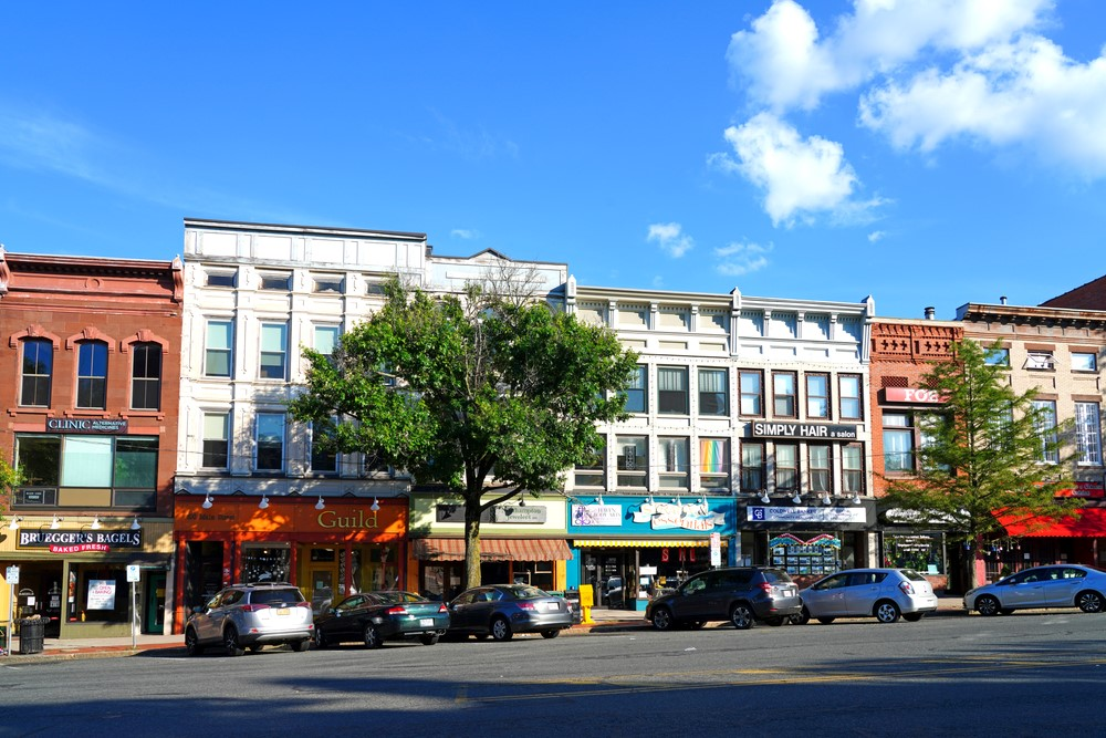 Buildings in downtown Northampton Massachusetts against a blue sky with clouds