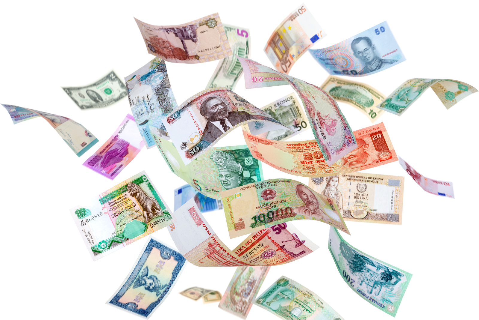 Colorful banknotes from different countries floating on a white background