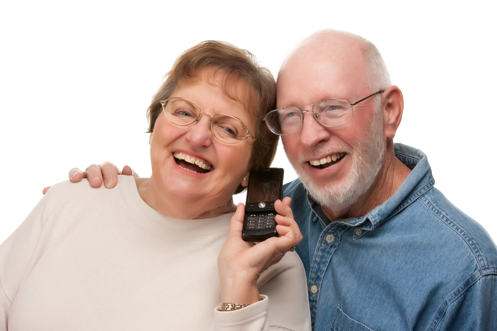 Happy Senior couple both leaning in to listen to a cell phone