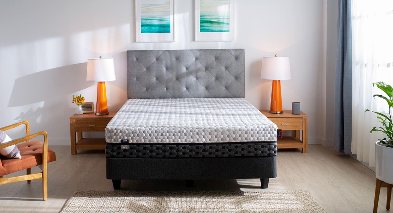 Layla Two tone gray mattress on a gray bedframe with wood night stands on both sides