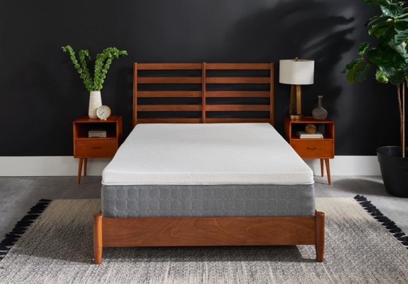 Tempur Pedic mattress with topper on a wood bed frame with wood table night stands