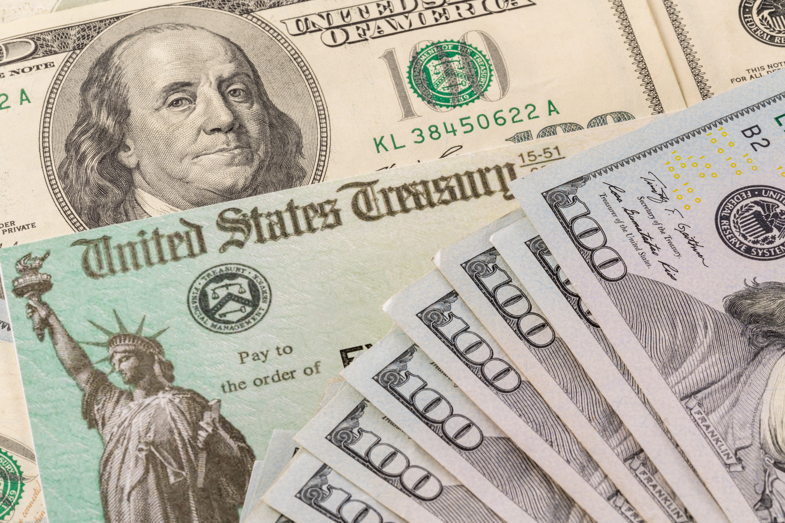 US Stimulus check with hundred dollar bills fanned out