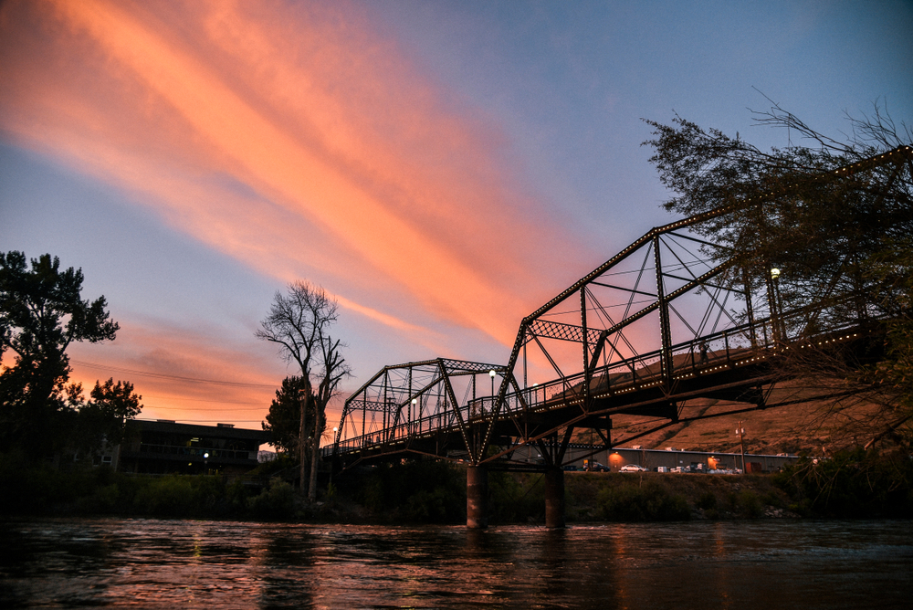 A bridge crossing a river in Missoula at sunset