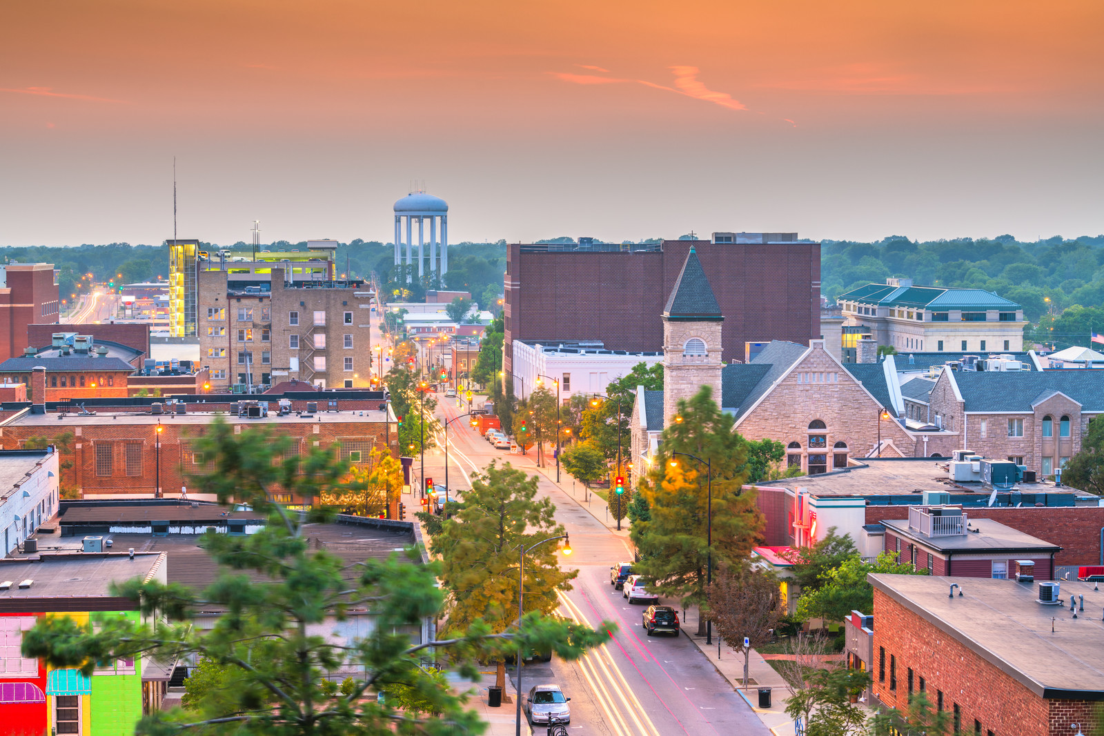 Downtown skyline Columbia Missouri with green trees in the background