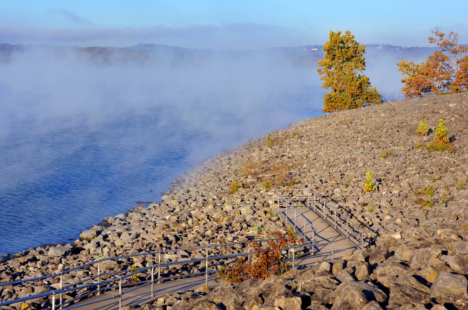 Peninsula observation loop with ramp and observation points to look at the scenic lake on table rock lake in Branson, Missouri, at early light with a light fog still hovering over the lake