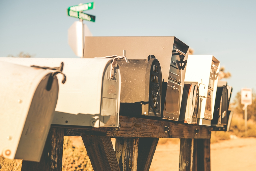 A selection of mail boxes on an American desert road