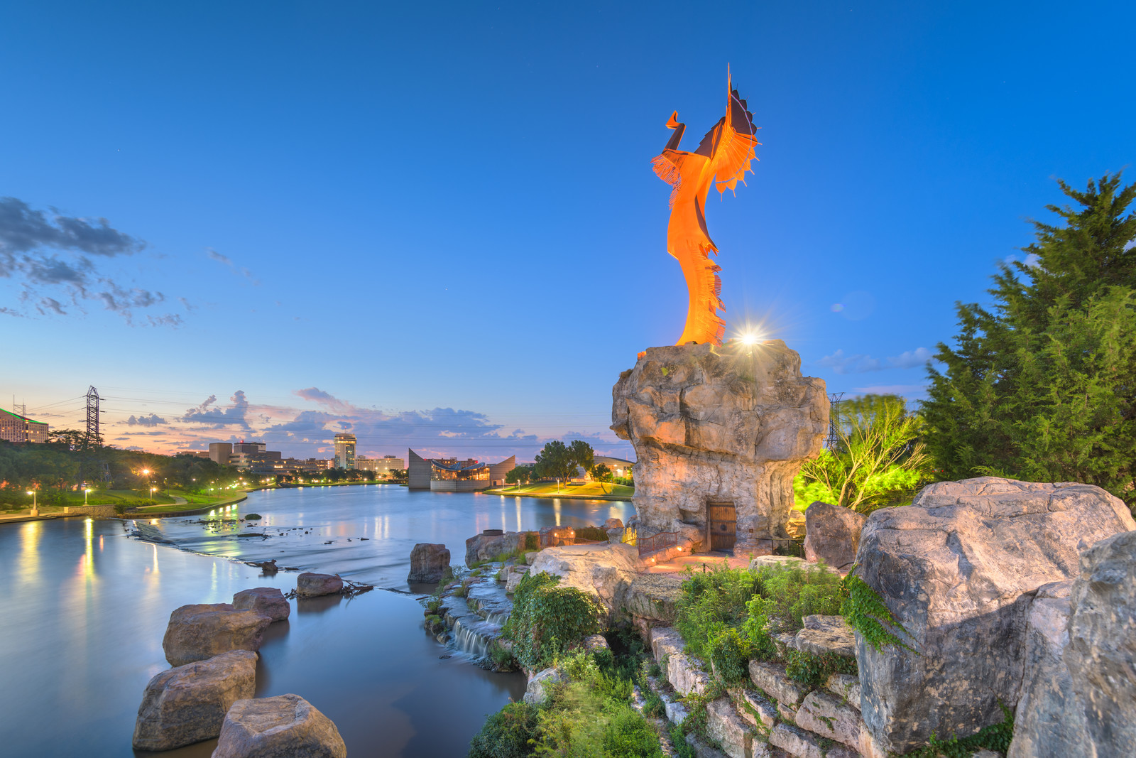 Wichita, Kansas- little Arkansas river at the keeper of the plains with the witchita skyline in the background at dawn