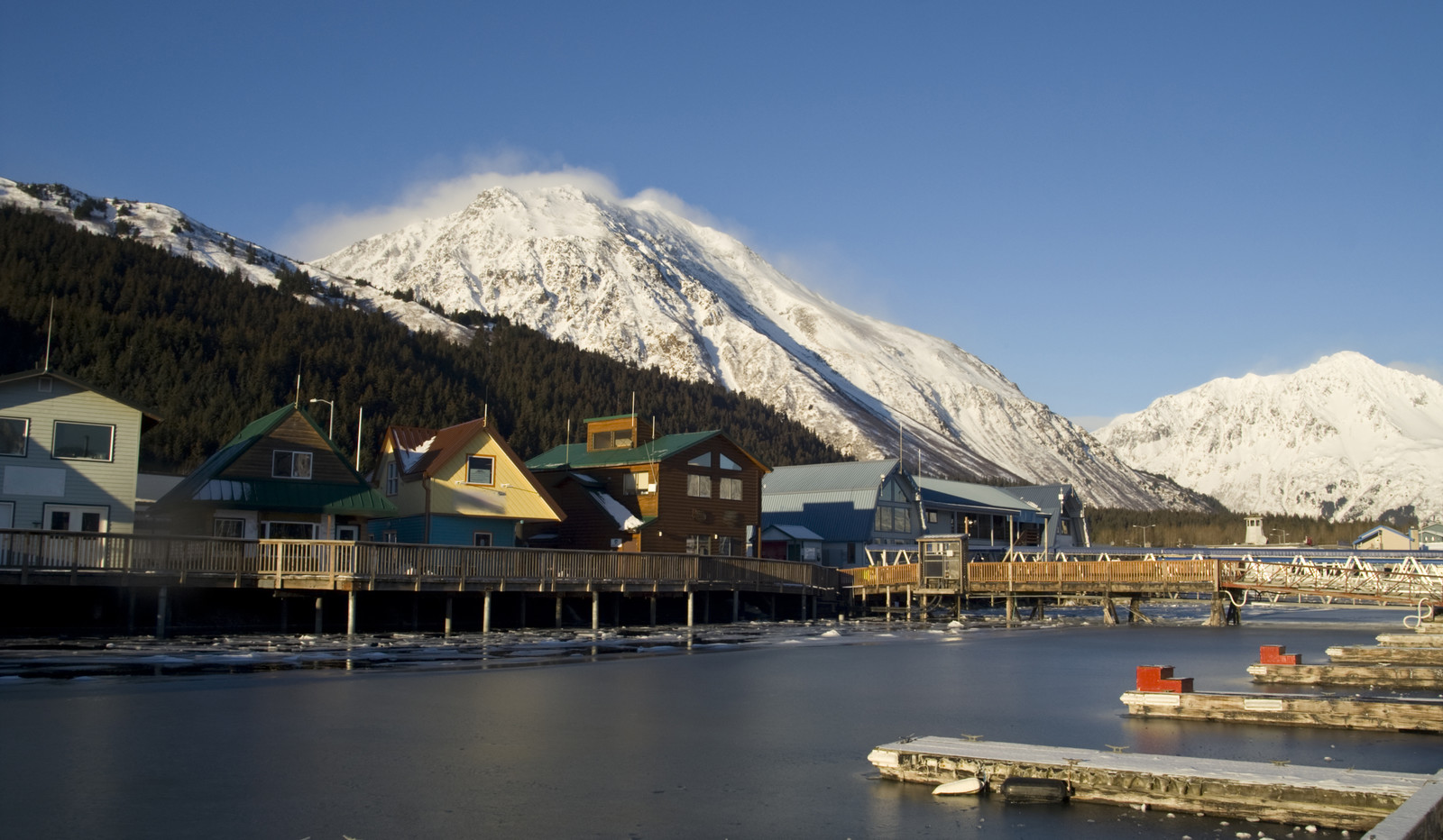 Seward Alaska With Homes along Resurrection Bay's harbor with snowy mountains in the background