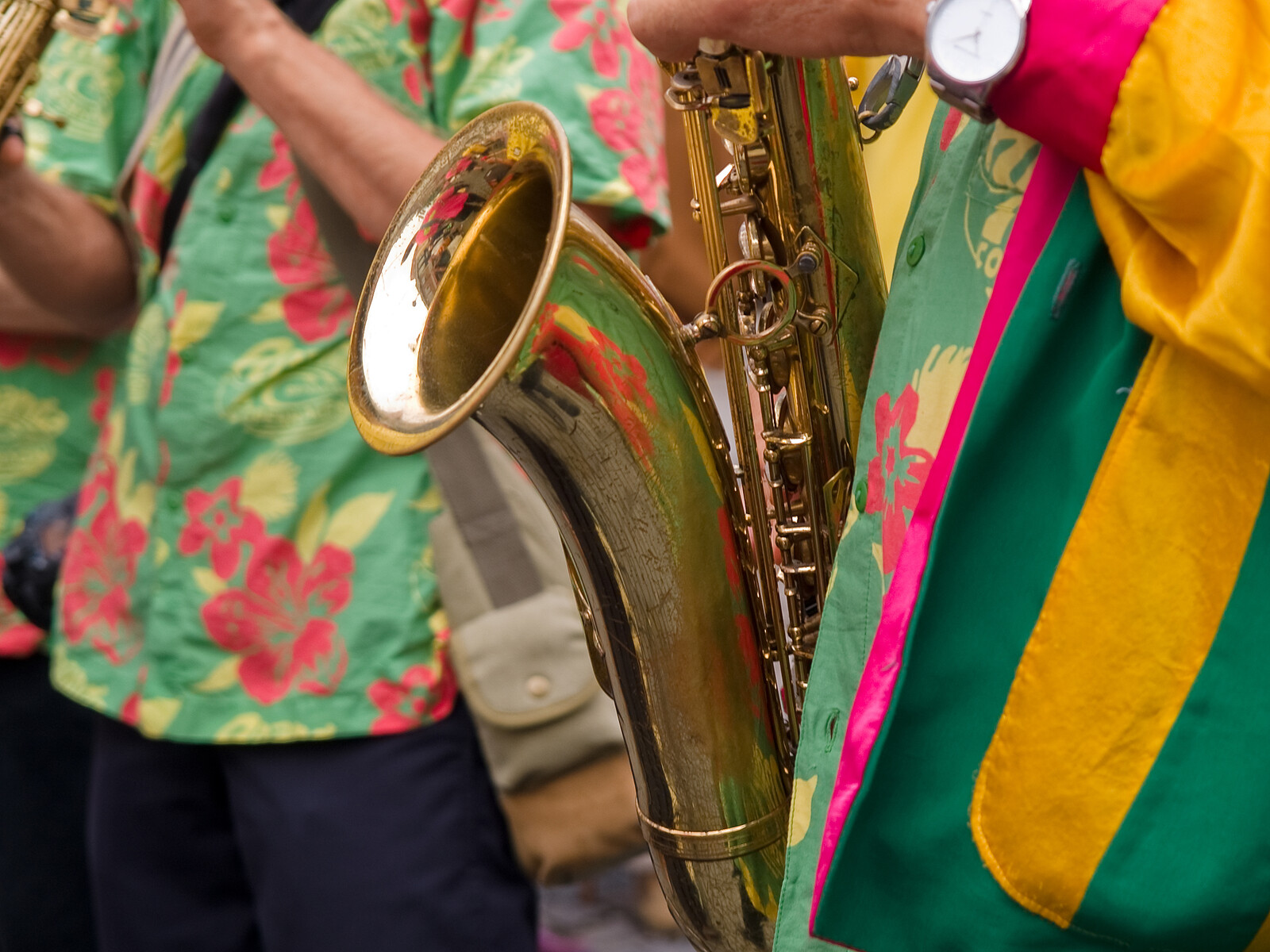Closeup of a saxaphone player in colorful festival clothes in the Caribbean