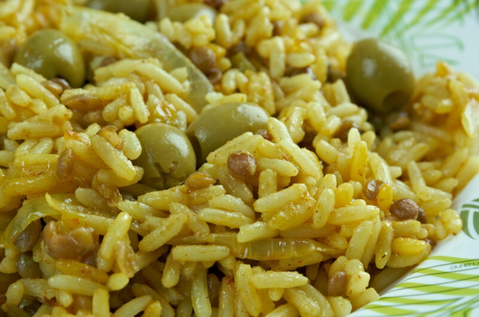 Up close photo of Arroz con Gandules showing the seasoned rice and pigeon peas